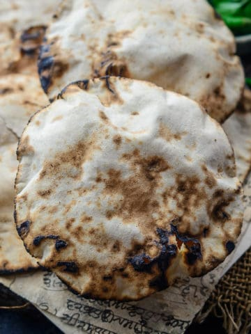 Khamiri Roti is a traditional Indian bread that was a staple in the Mughal era. It is made with whole wheat flour, yeast, and milk and is extremely soft and spongy. Do try this one for your festive meals.