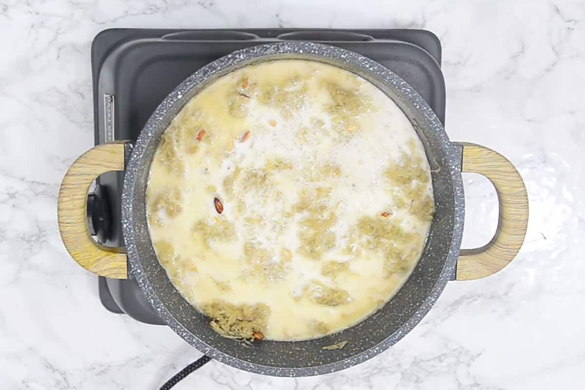 Milk added in the pan.