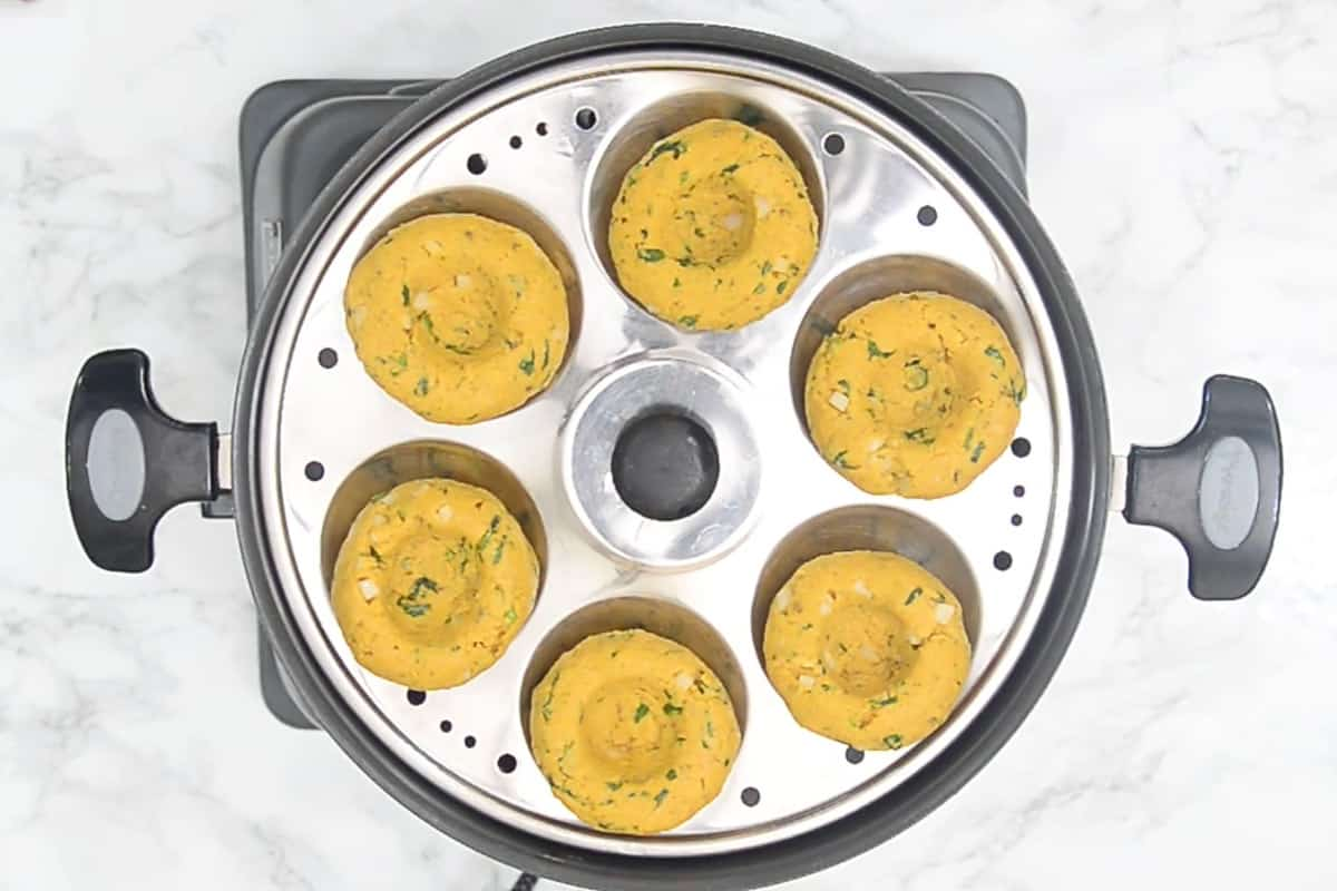 Dhokla arranged on a idli steamer.