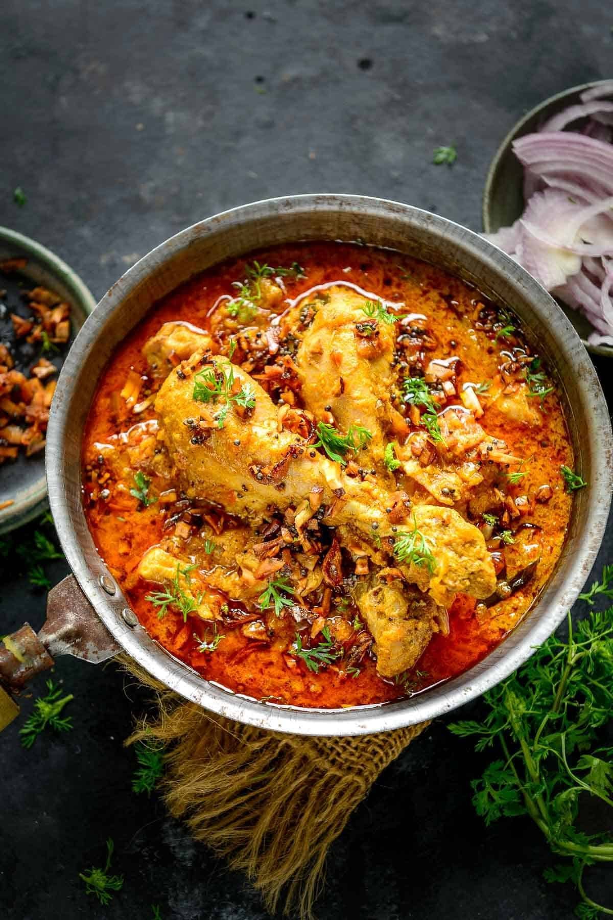Malabar Chicken Curry served in a bowl.