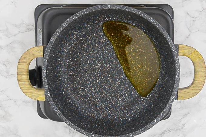 Mustard oil heating in a pan.