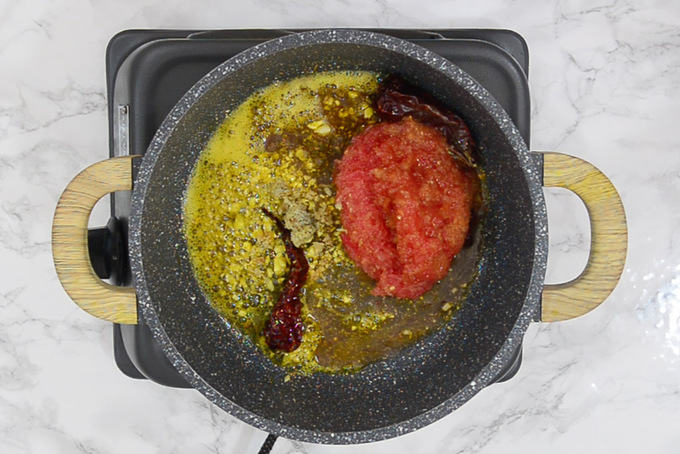 Tomato and ginger added in the pan.