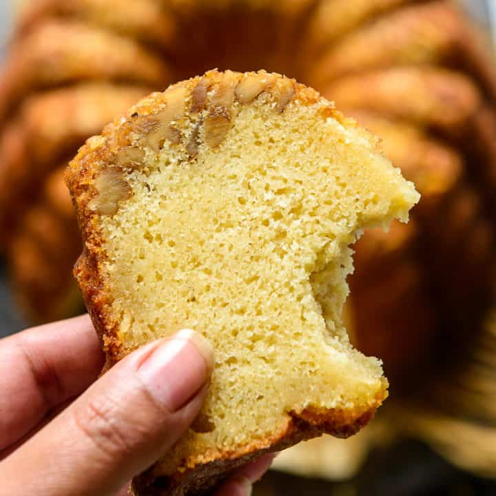 Rum Cake is a deliciously moist cake drenched with rum. Make this tender cake with great crumbs from scratch for a family get together, Christmas or holidays. Here is how to make this cake.