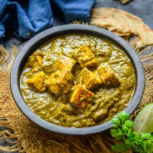 Creamy Saag Paneer is a delicious Indian curry made using a mix of green leafy vegetables and fried cubes of paneer. It is easy to make and goes well with Indian bread like Naan or Paratha. Here is how to make it.