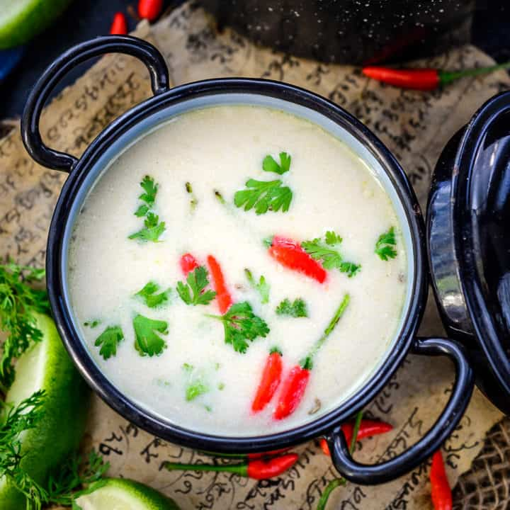 Tom Kha is an authentic Thai soup made with fragrant herbs, spices, mushroom and coconut milk. This soup can be made vegetarian or with chicken or shrimp. Here is how to make it.