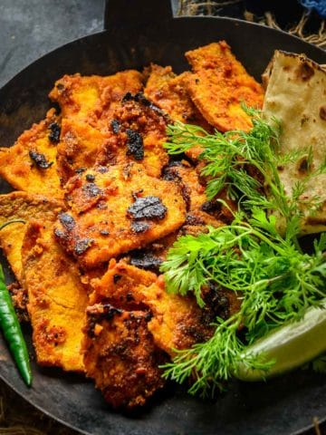 Yam Fry or Suran Fry is an easy recipe where Yam is cleaned and pan-fried along with everyday spices till it turns crispy and brown in color. Perfect for weekday meals, serve it as a side dish, or along with Tawa Parathas. Here is how to make it.