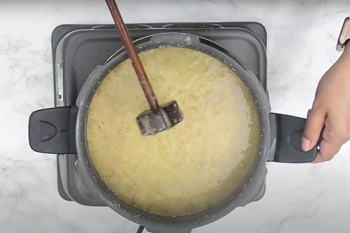 Ready bajra khichdi whisked using a wooden or wire whisk.