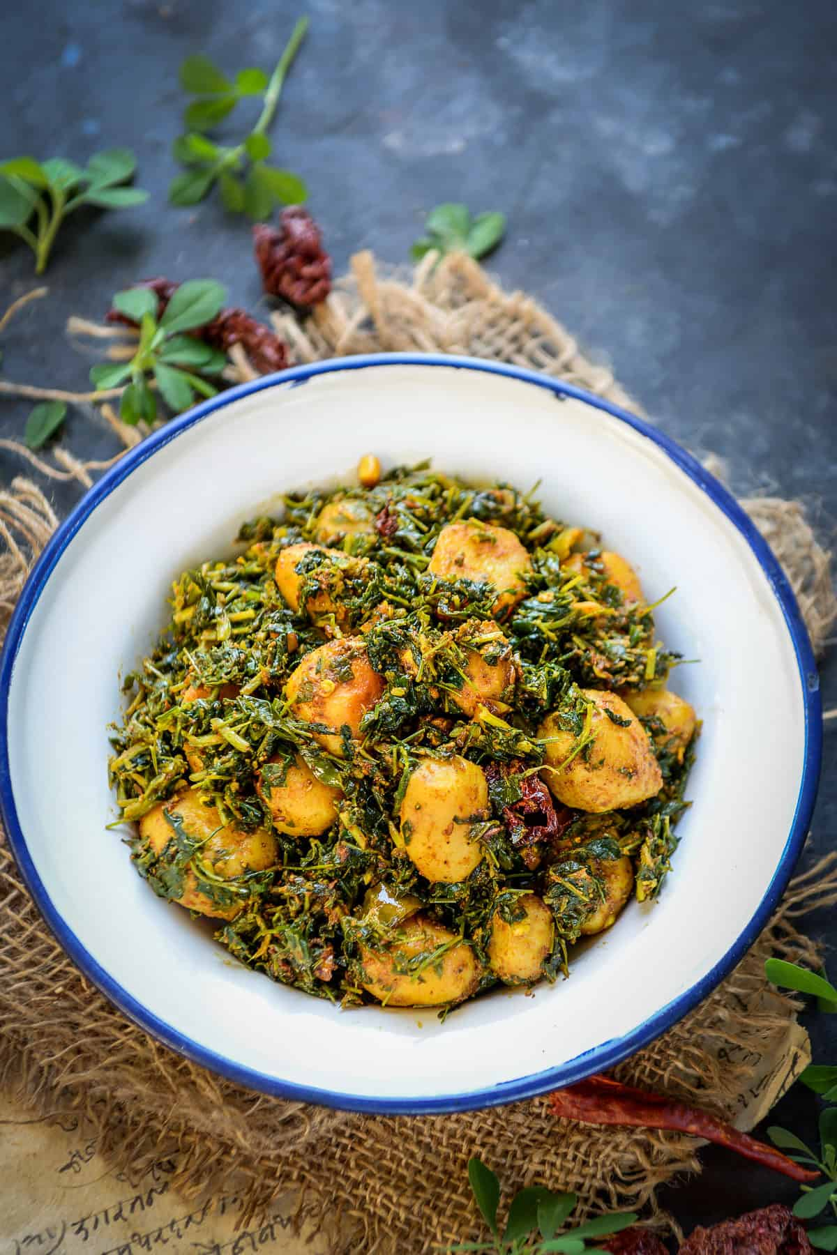 Aloo methi served in a bowl.