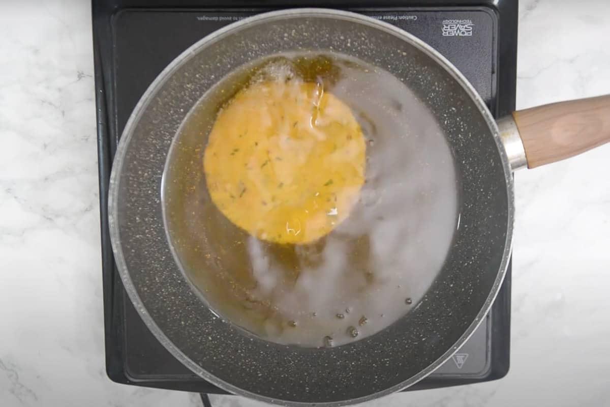 Poori dropped in hot oil.