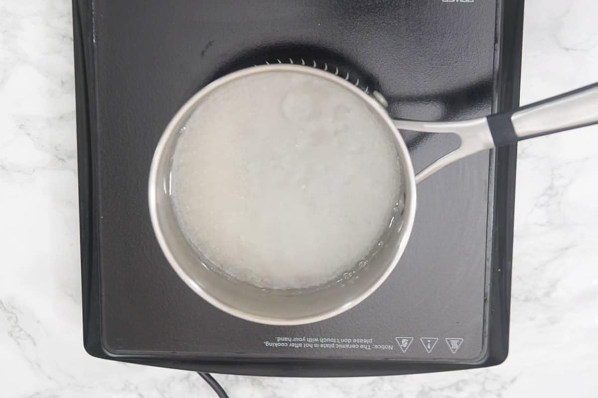 Water and sugar added in a pan.