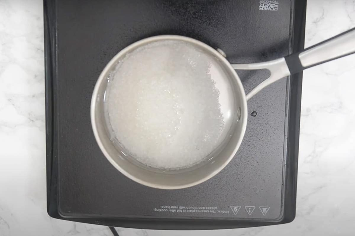 Water and sugar heating in a pan.