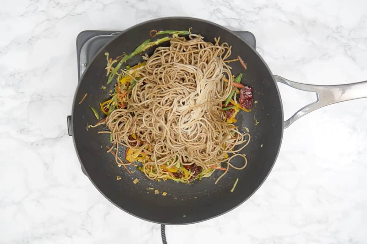 Cooked noodles added in the pan.