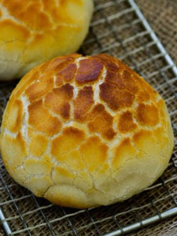 Dutch Crunch Bread or Tigerbrood is a soft and chewy bread inside covered with a crunchy layer that looks like Tiger's skin. Here is how to make a perfectly baked bread at home.