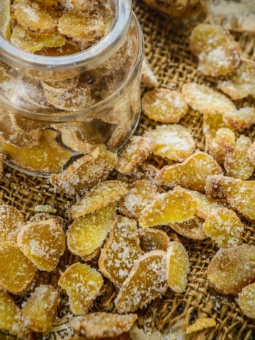 Ginger Candy is thinly sliced ginger coated in sugar syrup which will surely satisfy your sweet tooth. Make this DIY crystallized candied ginger and enjoy as candy or use in your cookies or fruit cake. Here is how to make it.