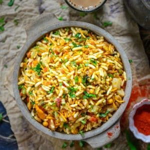 Spicy & Tangy Jhal Muri (Savory Puffed Rice) is a popular street food of Kolkata made using puffed rice. The pungent taste of raw mustard oil makes it quite unique.