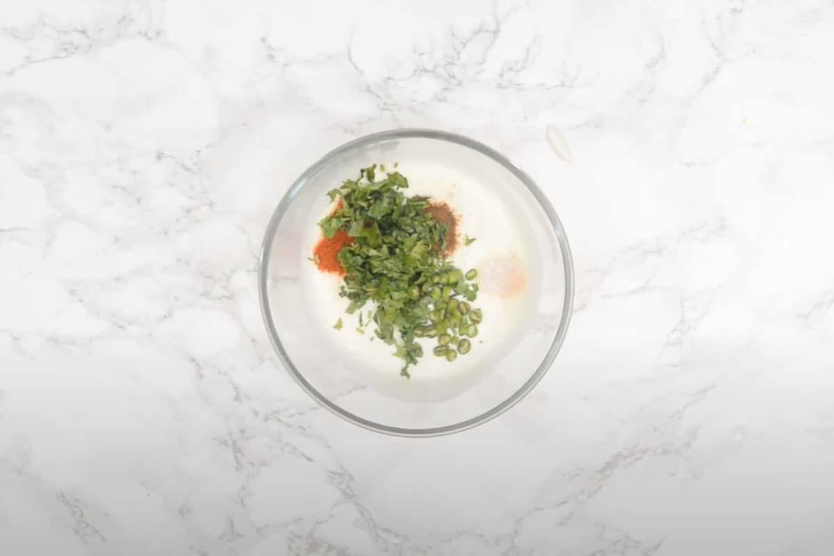Salt, roasted cumin powder, red chilli powder, fresh coriander, and green chilli added in the bowl.