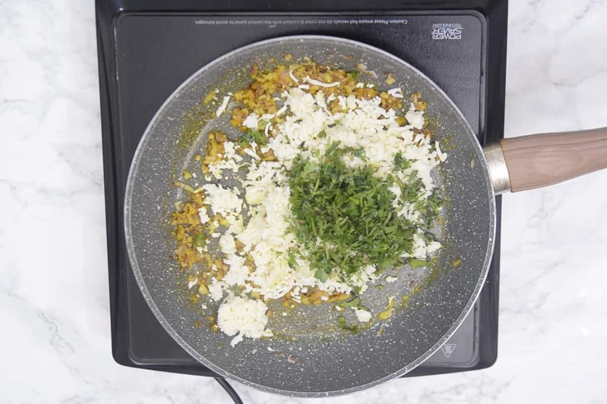 Paneer and coriander added in the pan.