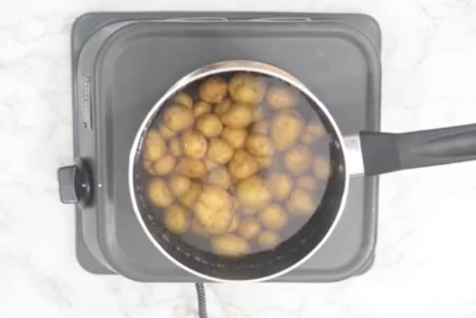 Potatoes boiling in salted water.