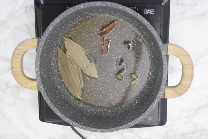 Whole spices added in hot oil.