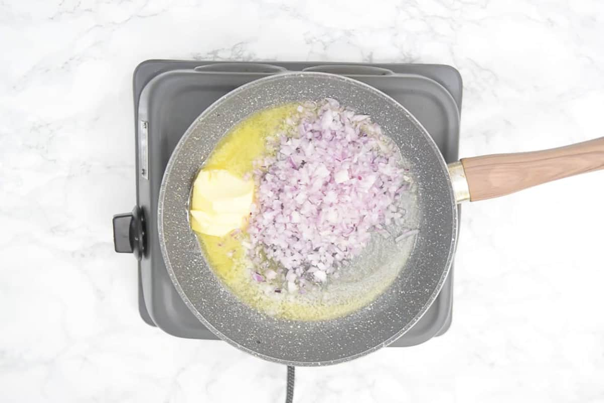 Butter and onion added in a pan.