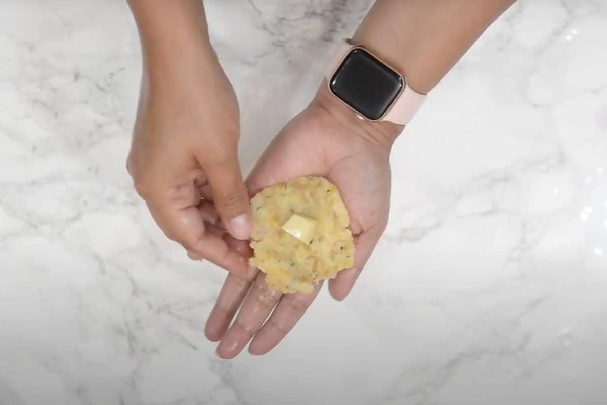 Mozzarella cheese kept in the centre of the potato mixture.