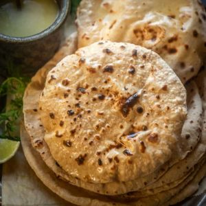Roti, Chapati or Phulka is an Indian flatbread made using whole wheat flour. It;s a simple everyday bread in most Indian households. Here is how to make perfect soft roti recipe.