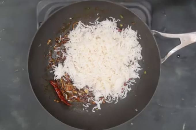 Cooked rice added in the pan.