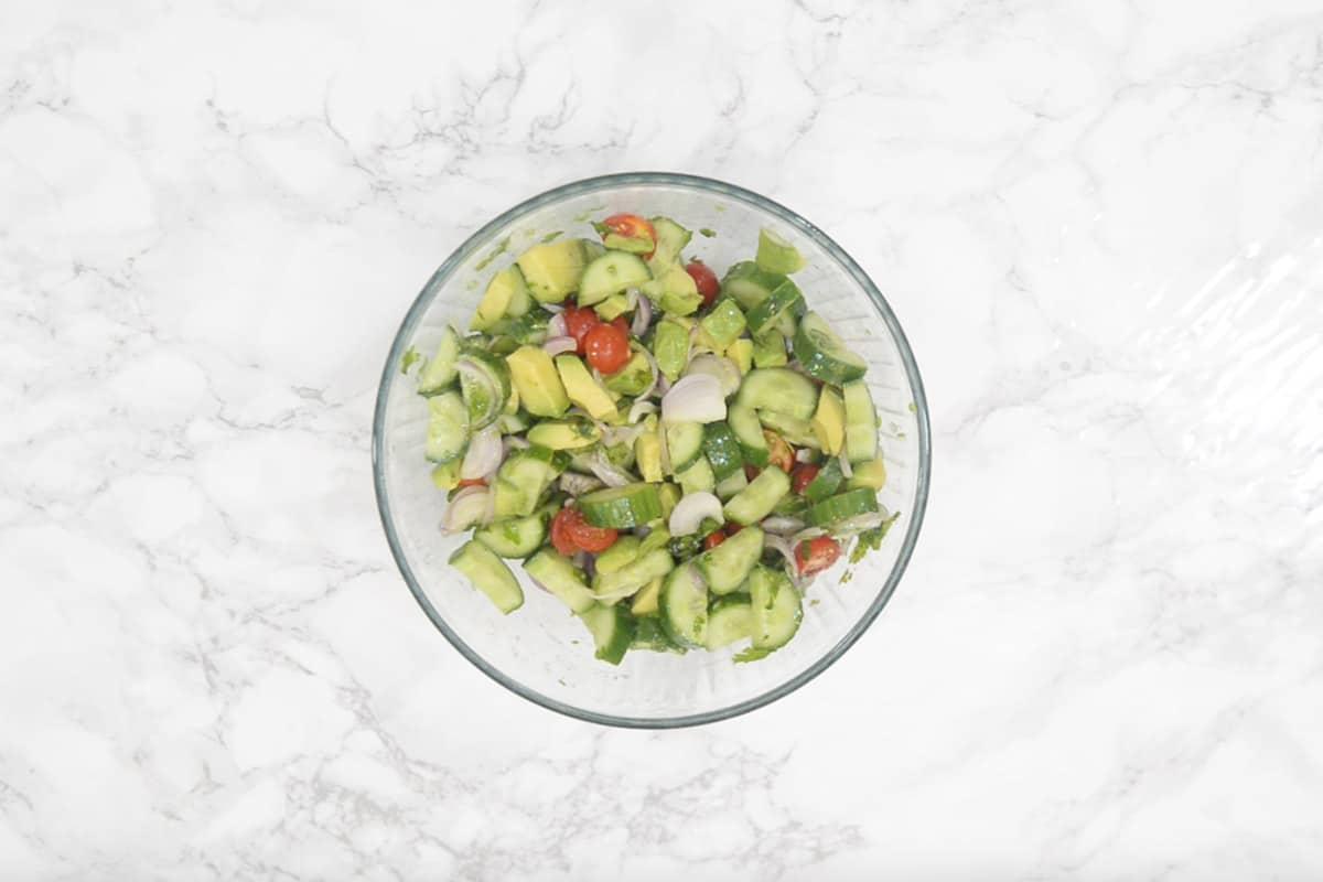 Ready cucumber avocado salad.