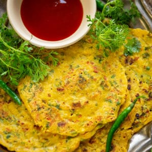 Besan Chilla is an Indian style savory pancake made using chickpea flour. It is also called as veg omelette and is a great dish to serve for breakfast or keep for tiffin box. Here is how to make it.