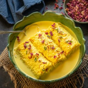 Bread Malai Roll is an Indian sweet where white bread slices are stuffed with a thick rabdi and then dunked in flavourful reduced milk. Here is how to make it.