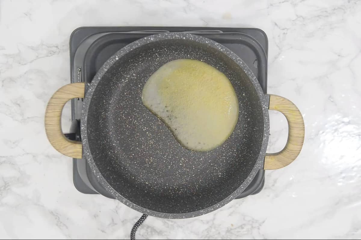 1 tbsp ghee heating in a  pan.
