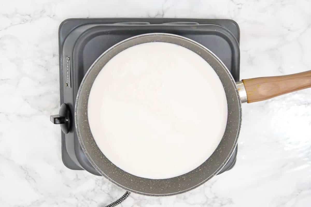 Milk for making rabdi heating in a pan.