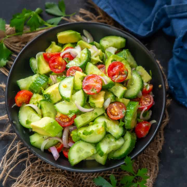 This healthy Cucumber Avocado Salad is a delicious combination of my Summer favorites, Cucumber and Avocado which is flavored with a simple zesty dressing. Here is how to make it.