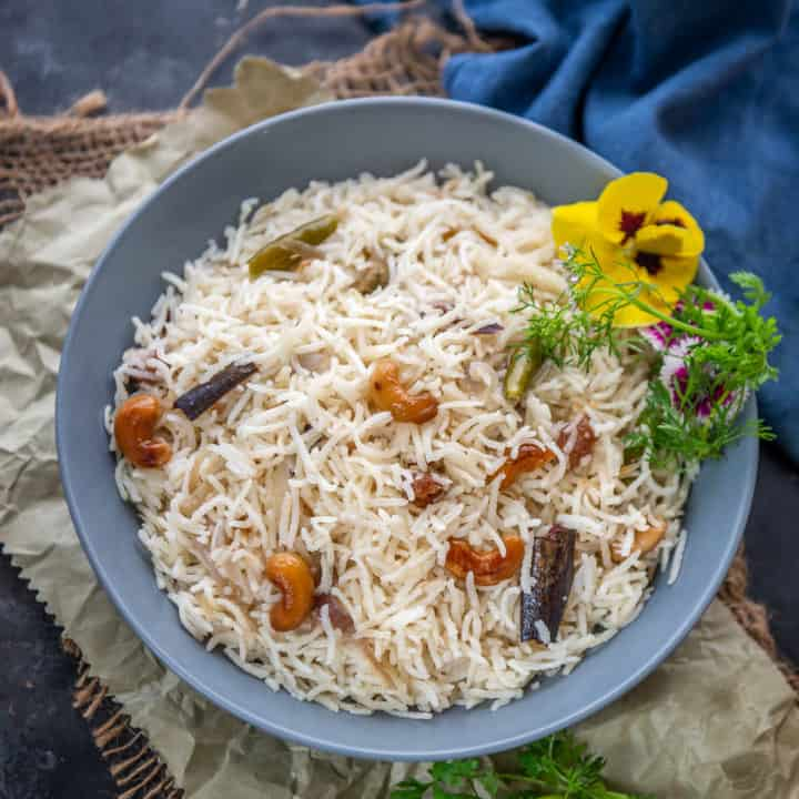 Ghee Rice or Neychoru is a Kerala Style Rice dish where rice is cooked with lots of ghee and spices. Here is how to make it.
