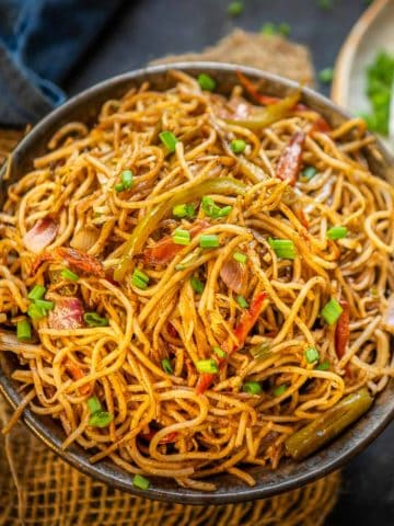 Hakka Noodles are easy and delicious wok-tossed noodles. Thin noodles are tossed with veggies and sauces on high flame to make this Indo Chinese delicacy. Serve it with Veg Manchurian or Paneer Chilli and you are sorted. Here is how to make it.