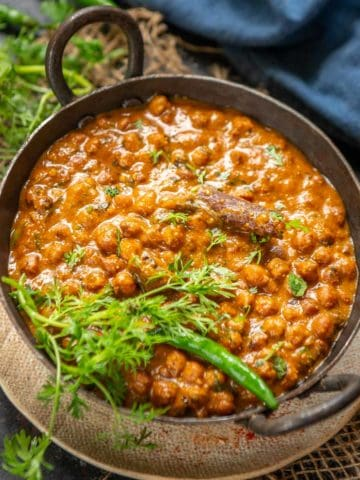 Kala Chana or Black Chana is a very good source of vegetarian protein. It can be cooked in a variety of forms like chaat, curries, or ghugni. Here is how to make Kala Chana Curry.