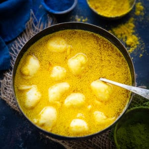 Kanji Vada is a traditional Rajasthani dish where lentil fritters are added in a mustard fermented water. It is a must make for the Holi festival. Here is how to make it.