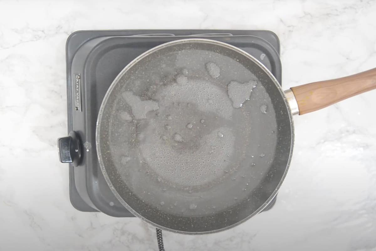 Water boiling in a pan.