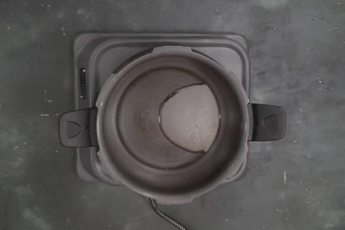 Ghee heating in a pressure cooker.