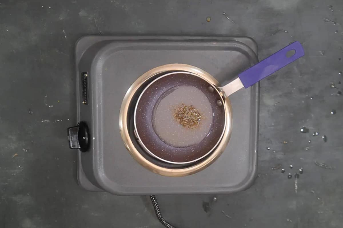 Cumin seeds added in hot ghee.