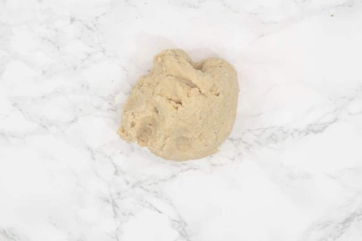 Dough transferred on a working surface.