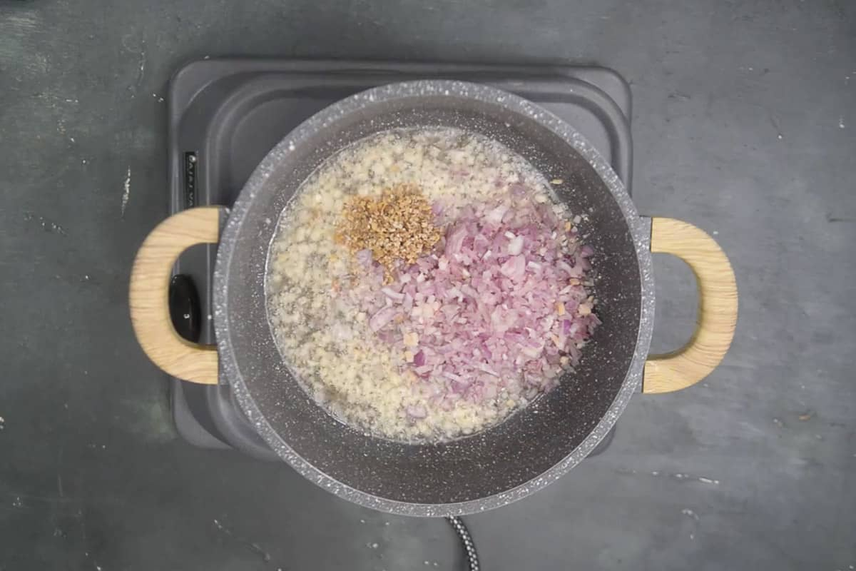 Onion and ginger added in the pan.