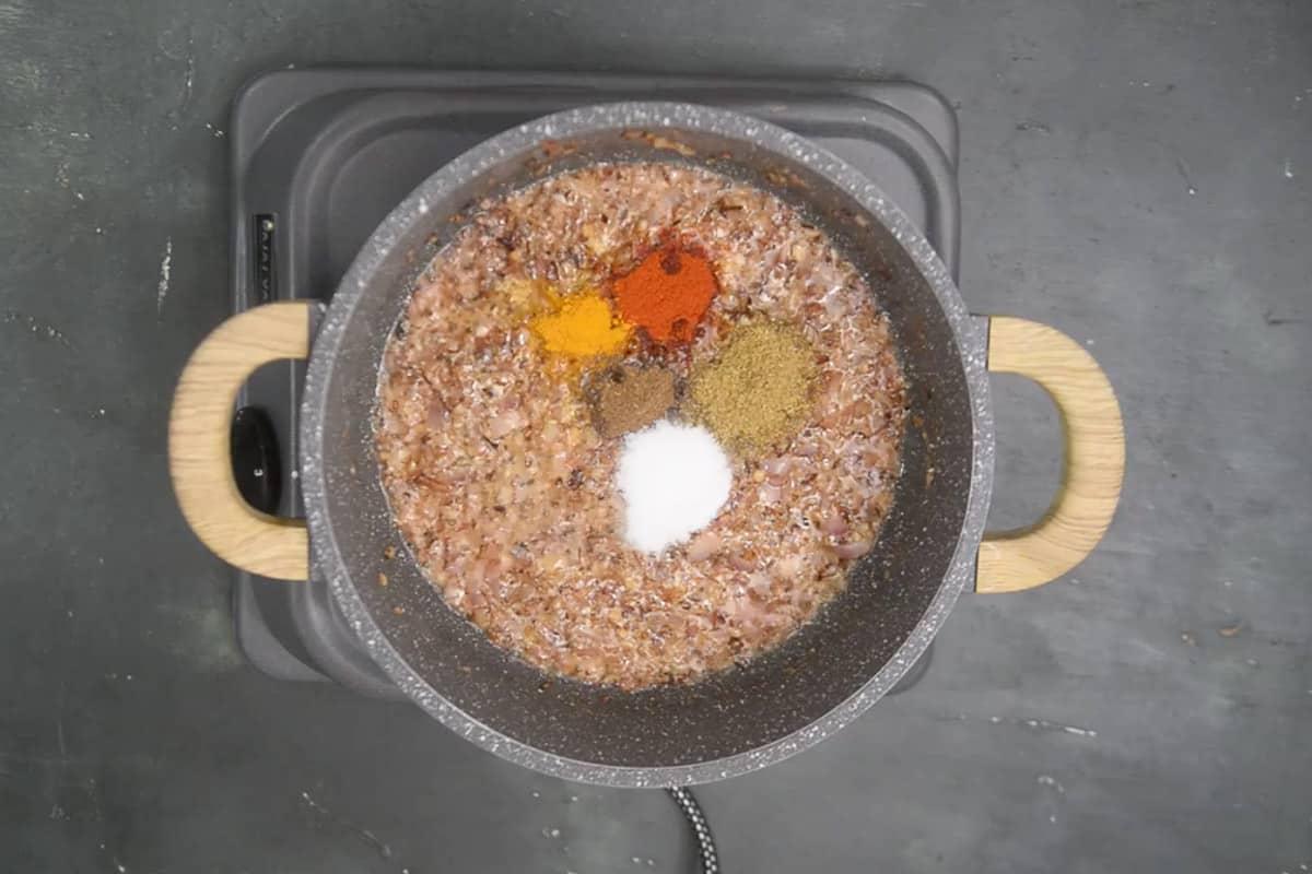 Coriander powder, Kashmiri red chilli powder, turmeric powder, garam masala powder and salt added in the pan.
