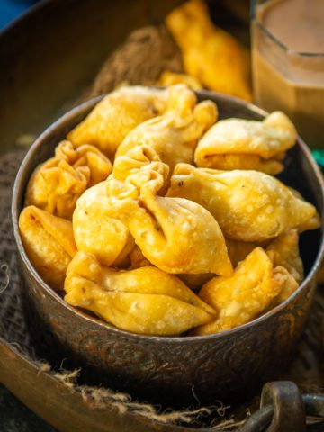 Moong Dal Samosa is a delicious Indian snack where the samosa is filled with a spicy lentil filling. It's great as a tea time snack. Here is how to make it.