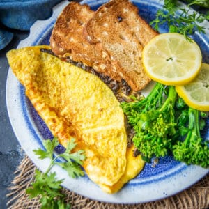 This cheesy Mushroom Omelette is a delicious and healthy breakfast option which is super easy to make as well. Here is how to make it.