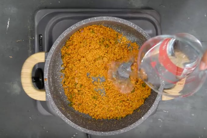 Warm water added in the pan slowly.