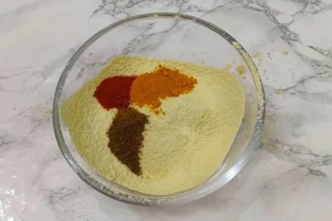 Chilli powder, turmeric powder, garam masala added in besan.
