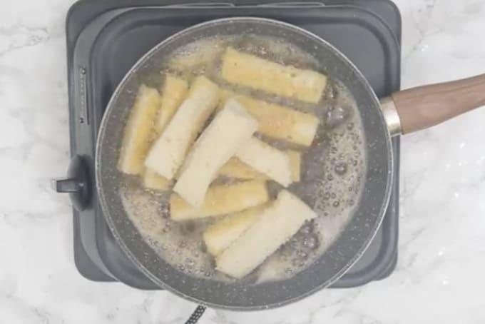 Bread frying in ghee.