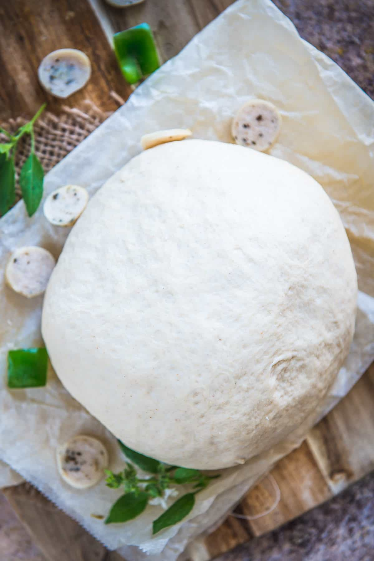 Pizza Dough kept on a parchment paper.