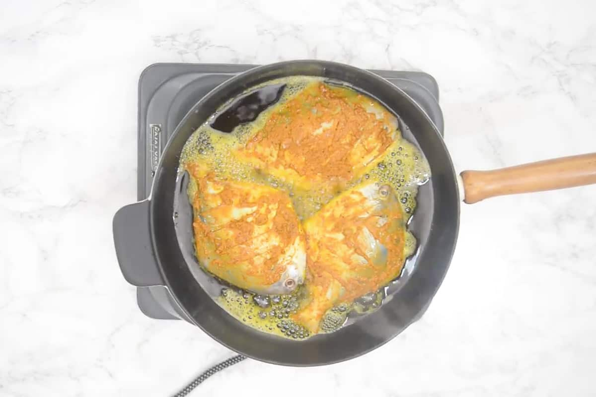 Fish added in the pan.